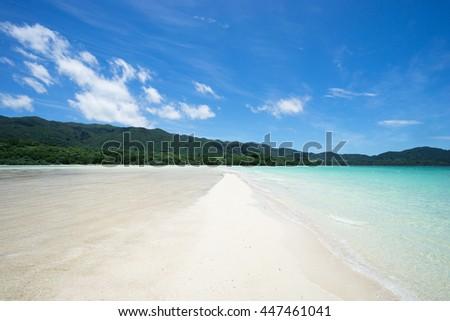 Tropical paradise beach with clear blue lagoon water, Ishigaki Island, Okinawa, Japan - stock photo