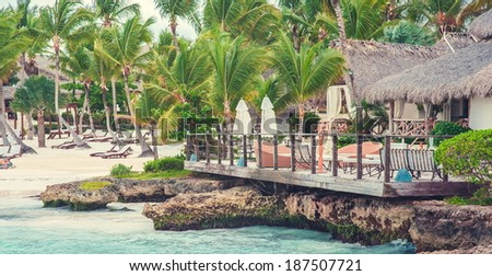 Tropical Paradise. Dominican Republic, Seychelles, Caribbean, Mauritius, Philippines, Bahamas. Relaxing on remote Paradise beach. Vintage - stock photo