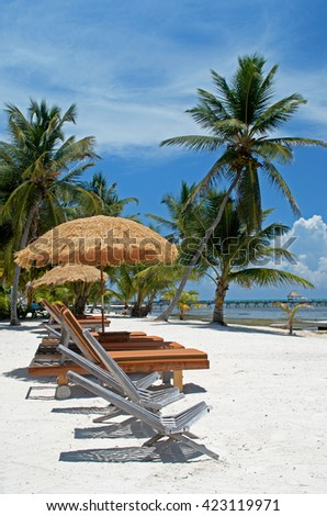 Tropical Paradise in Ambergris Caye-lounging on the beach - stock photo