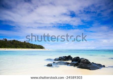 Tropical paradise. White sand beach, turquoise ocean and blue sky. - stock photo