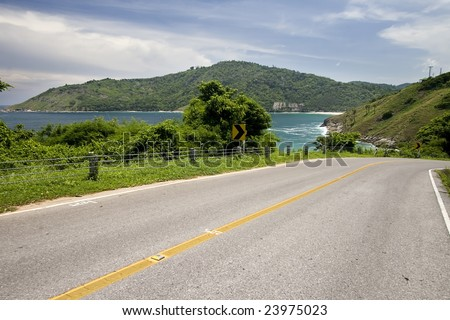 Tropical path leading through the mountains at south of Phuket Island, Thailand - stock photo