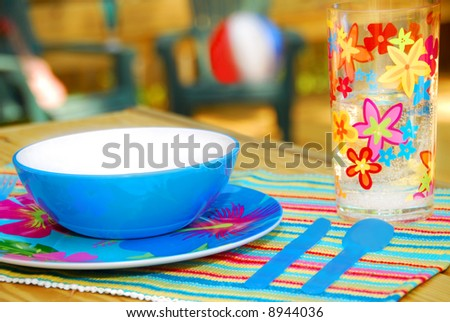 Tropical Place Setting on Deck, Ready for Entertaining - stock photo