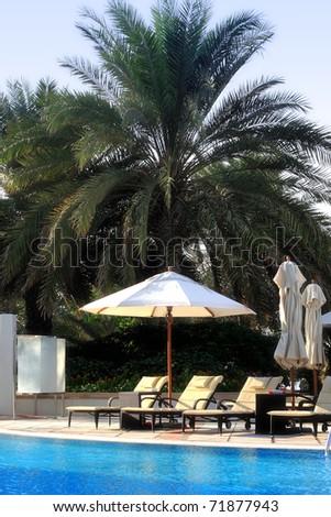 Tropical poolside area - stock photo