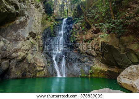 Tropical rain forest waterfall on Joao Gomes River, levada do Bom Sucesso walk, Funchal, Madeira island, Portugal
