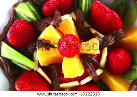 tropical raw fruits with in hot chocolate cream