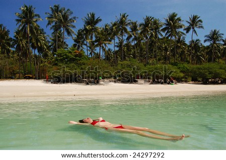 Tropical relax. Happy woman on beach vacation - stock photo