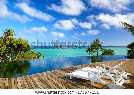 Tropical relax near wimming pool in Mauritius - stock photo