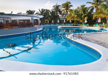 Tropical resort at swimming pool in Mexico - stock photo
