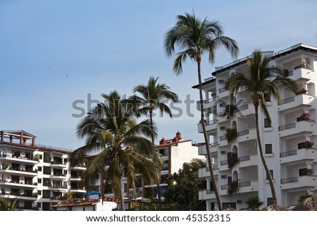 Tropical resort - hotel and condo - on a beach in Puerto Vallarta, Mexico - stock photo