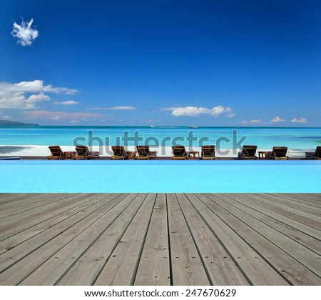Tropical resort hotel infinity swimming pool with empty wooden platform