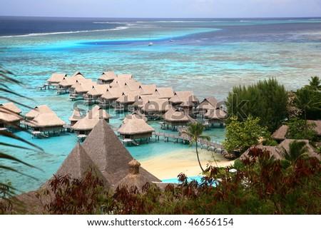 tropical resort on blue lagoon - stock photo