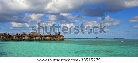 Tropical resort on turquoise lagoon