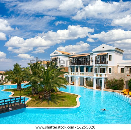 Tropical resort with palm trees and girl in swimming pool - stock photo