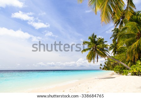 tropical sand beach against blue sky, vacation concept - stock photo