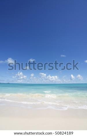 Tropical sand, beach and blue sky - stock photo