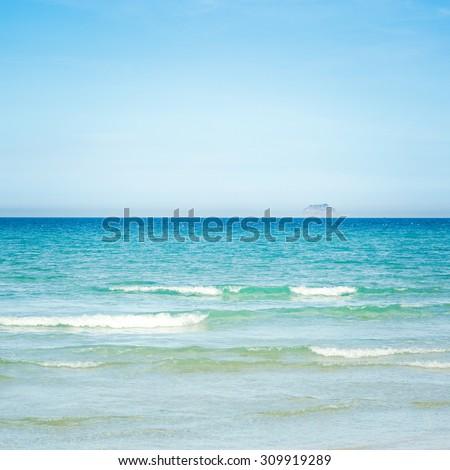 Tropical sandy beach at summer sunny day - stock photo