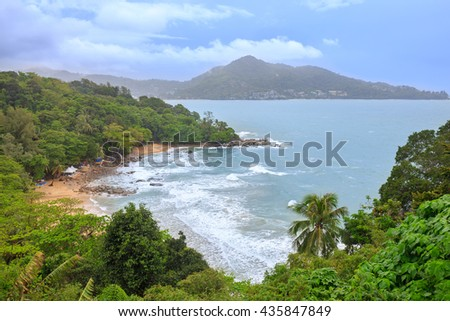 Tropical sandy beach landscape from high view point. Beautiful turquoise ocean and people relaxing in Laem Sing and Kamala beach Phuket, Thailand - stock photo
