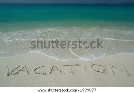 """Tropical Sandy Beach With """"Vacation"""" Inscription on Sand. Straight View. - stock photo"""