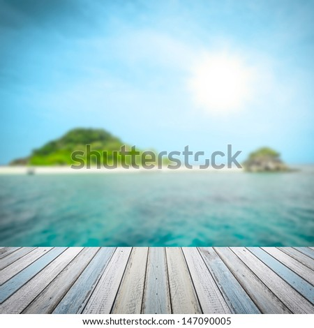 Tropical sea ,island and wooden floor background - stock photo