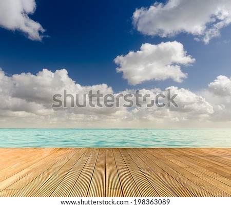 Tropical seascape with empty wooden jetty giving a warm relaxing feeling - stock photo