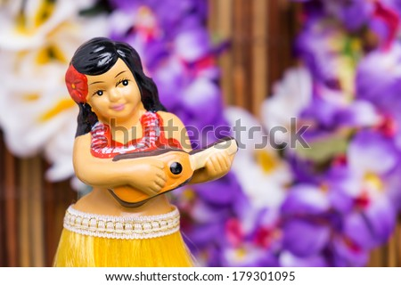 Tropical setting for a Hula girl doll - stock photo