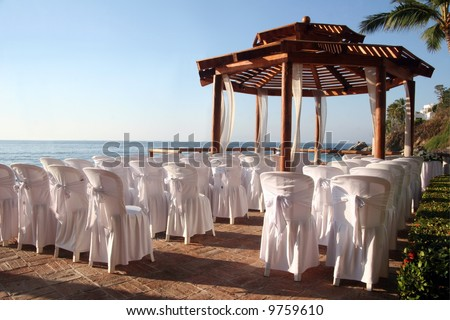 Tropical settings for a wedding on a beach - stock photo