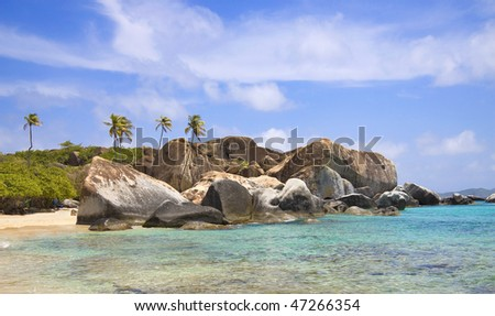Tropical shoreline of the virgin islands, covered with large boulders. - stock photo