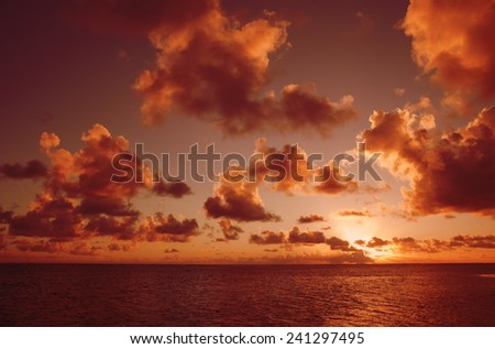 Tropical Sky with Cloudscape and Sun - Rarotonga, Cook Islands, Polynesia - stock photo