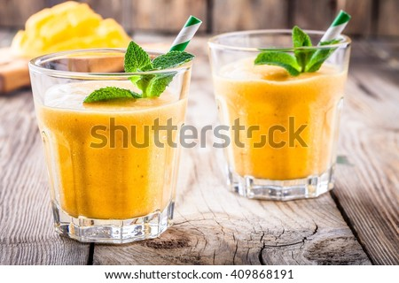 tropical smoothie in a glass with mango and banana - stock photo