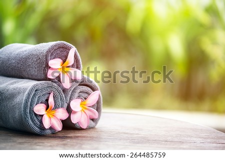Tropical spa, beautiful fresh pink frangipani flower, outdoor setting spa  - stock photo