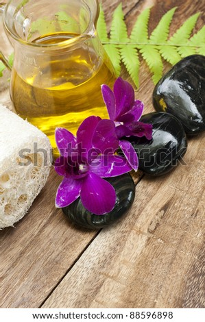 tropical spa setting with flower - stock photo