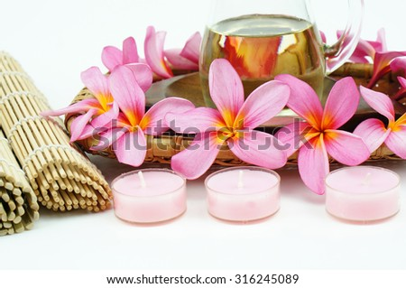 Tropical spa setting with Pink Plumeria flowers isolated on white background - stock photo