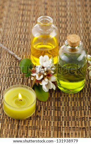 Tropical spring flower with massage oil,candle on mat