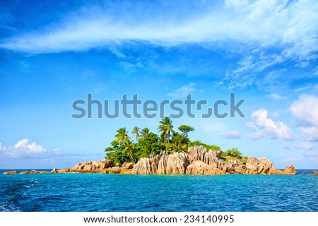 Tropical St. Pierre Island with palms and granite rocks, Seychelles - stock photo