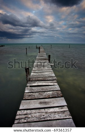 tropical storm on Caye caulker Belize at sunset - stock photo