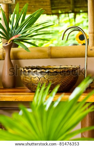 Tropical style restroom - stock photo