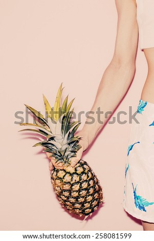 Tropical Summer. Fashion girl with Pineapple. Vanilla style colors - stock photo