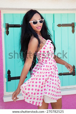 Tropical summer holiday fashion beauty concept, cheerful attractive woman wearing sunglasses - stock photo