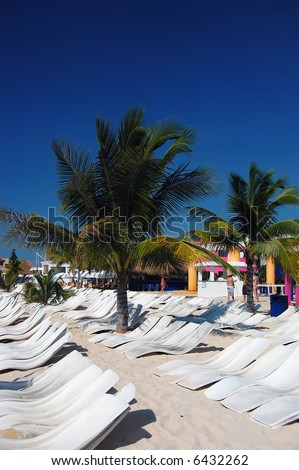 Tropical Sunbathing recliners in the Caribbean - stock photo