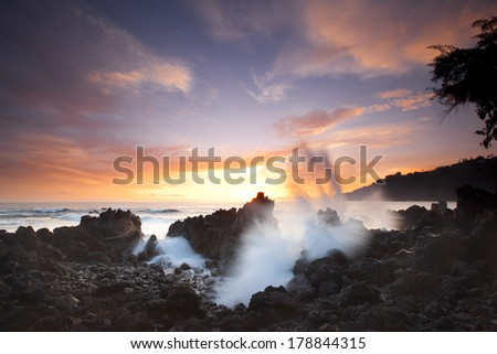 Tropical sunset at Laupahoehoe Point on the Big Island of Hawaii. - stock photo