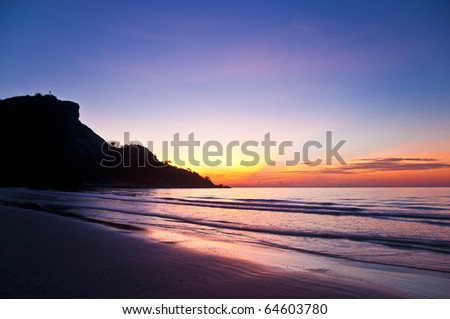 Tropical sunset on the beach - stock photo
