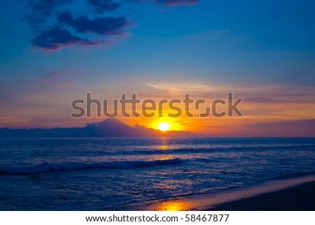 Tropical sunset on the beach. Lombok island. Indonesia - stock photo