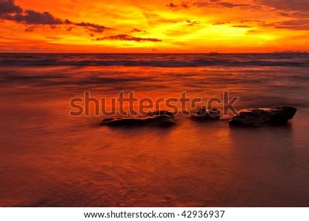 Tropical sunset on the beach. Phuket island. Thailand - stock photo