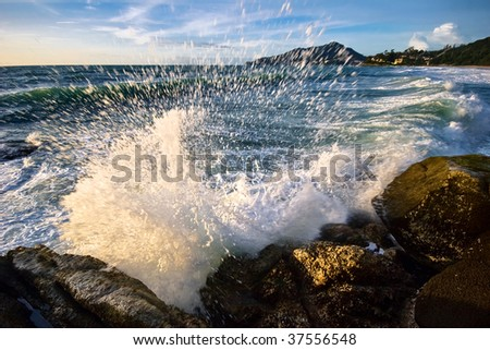 Tropical sunset on the rocks - stock photo