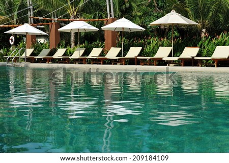 Tropical Swimming Pool Background - stock photo