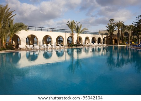Tropical swimming pool in holiday resort, island of Djerba, Tunisia, Africa - stock photo