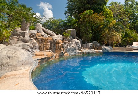 Tropical swimming pool in Mexico - stock photo