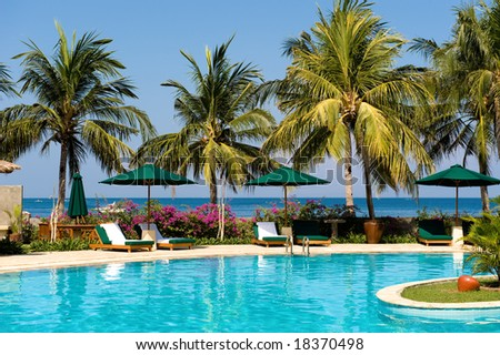 tropical swimming pool near the beach - stock photo