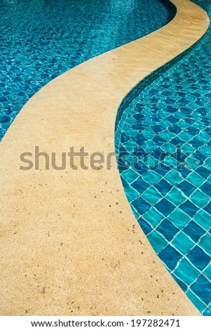 Tropical swimming pool with various curve pattern, taken outdoor