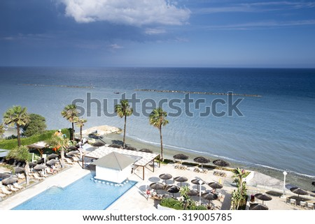 Tropical terrace with swimming pool and beautiful view to the sea - stock photo